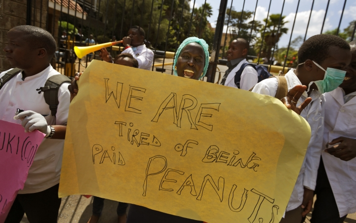FILE - In this Thursday, Dec. 8, 2016 file photo, Kenyan nurses and other health-workers on strike demonstrate over low pay at Uhuru Park in downtown Nairobi, Kenya. A Kenyan judge Monday, Feb. 13, 2017 has jailed seven officials of the medics union for failing to call off a two-month strike by doctors at public hospitals that has seen at least a dozen die due to lack of medical care. (AP Photo/Ben Curtis, File)