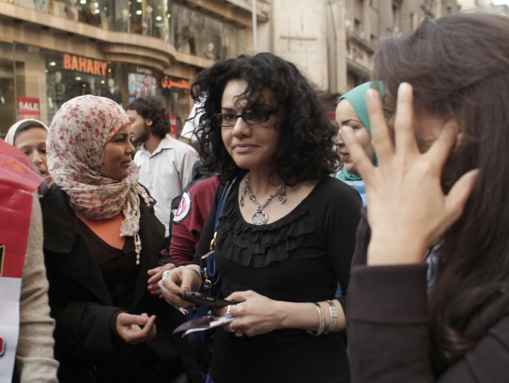 FILE - In this Thursday, March 8, 2012 file photo, Egyptian activist Samira Ibrahim, left, and Mona Eltahawy, a prominent Egyptian-born U.S. columnist, center, march in downtown Cairo, Egypt to mark International Women's Day. The Associated Press has found that the prominent American author is among dozens of activists, lawyers and human rights advocates who have been targeted in a sweeping cyberespionage campaign blamed on the Egyptian government. Booby-trapped emails sent to Eltahawy in December came from the same address behind the distribution of identical malicious messages to a host of other activists across Egypt.(AP Photo/Maya Alleruzzo, File)
