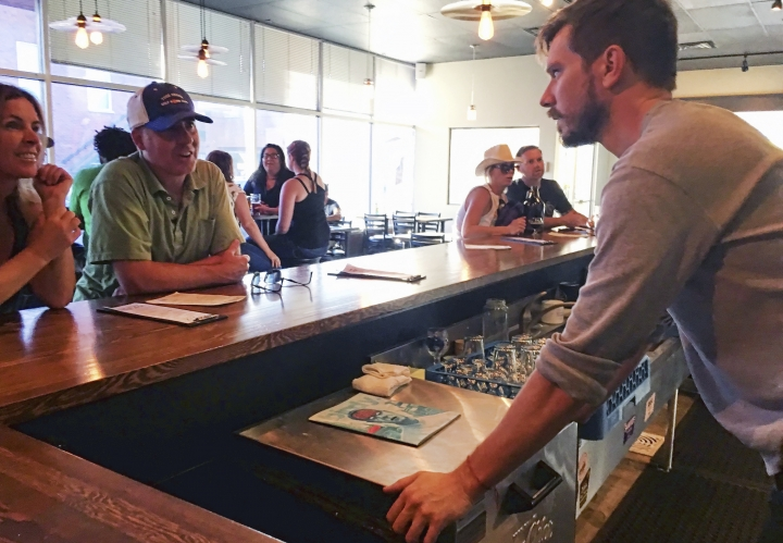"In this Sept. 17, 2016 photo, Austin Wiley, right, owner of Spangalang Brewery, talks to patrons at the bar in Denver's Five Points neighborhood. The historic black neighborhood was often called ""The Harlem of West,"" a place where Billie Holiday, Count Basie and Miles Davis performed and novelist Jack Kerouac tried to capture the spirit of the bebop movement in ""On The Road."" The brewery's name, Spangalang, is the term used to describe the bread and butter jazz cymbal rhythm. (AP Photo/Russell Contreras)"