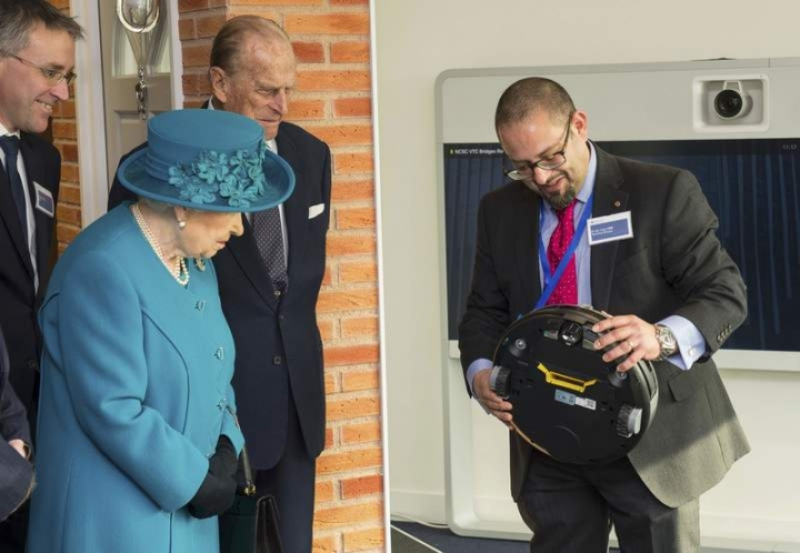 Technical Director Dr Ian Levy shows Queen Elizabeth and Prince Philip a robot vacuum cleaner which could be vulnerable to cyber attack, at the official opening of the National Cyber Security Centre (NCSC) in London, Britain, February 14, 2017. REUTERS/Dominic Lipinski/Pool
