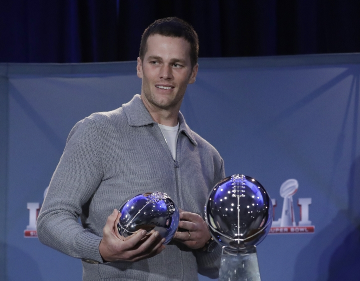 FILE - In this Feb. 6, 2017, file photo, New England Patriots quarterback Tom Brady walks off with his MVP trophy during a news conference after the NFL Super Bowl 51 football game in Houston. Zoo Atlanta announced Monday, Feb. 13, 2017, that it named a baby cockroach after Brady. (AP Photo/Morry Gash, File)