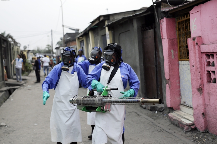 "FILE - In this Friday, July 22, 2016, file photo teams from MSF carry out fumigation efforts in the Yolo Sud neighborhood of Kinshasa, Democratic Republic of Congo, in a bid to kill the mosquitos that transmit yellow fever. The World Health Organization has declared an end to the yellow fever outbreak that killed about 400 people in Congo and Angola, calling it ""one of the largest and most challenging"" in recent years. The outbreak, first detected in Angola in late 2015, caused 965 confirmed cases and thousands of suspected cases in both countries, the WHO said in a statement Tuesday, Feb. 14, 2017. (AP Photo/Jerome Delay, File)"