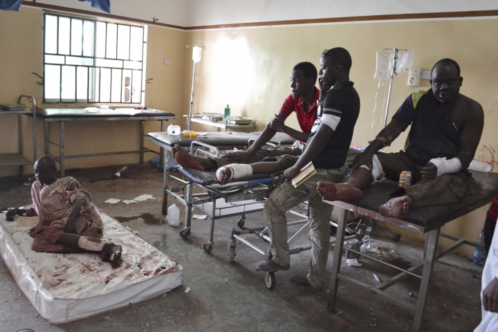 FILE- In this Monday, Sept. 21, 2015 file photo, Victims receive treatment at a hospital, after an explosion in Maiduguri, Nigeria. Nigerian President Muhammadu Buhari's nearly month-long medical leave in London is reminding his country's taxpayers that while they finance their leaders' health care abroad, they often are stuck with decrepit, ill-staffed government health facilities at home. (AP Photo/Jossy Ola File)