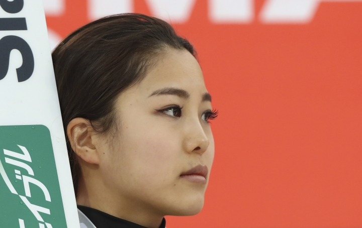 Japan's Sara Takanashi listens to the national anthem during the awards ceremony for the Ladies Normal Hill Individual of the FIS Ski Jumping World Cup in Pyeongchang, South Korea, Thursday, Feb. 16, 2017. Takanashi won for place in the competition. (AP Photo/Lee Jin-man)