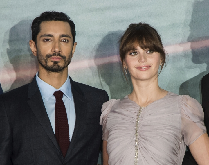 "FILE - This Dec. 13, 2016 file photo shows Riz Ahmed, left, and Felicity Jones at the premiere of the film ""Rogue One: A Star Wars Story,"" in London. Ahmed and Jones will serve as presenters at the Oscars ceremony on Feb. 26. (Photo by Vianney Le Caer/Invision/AP, File)"
