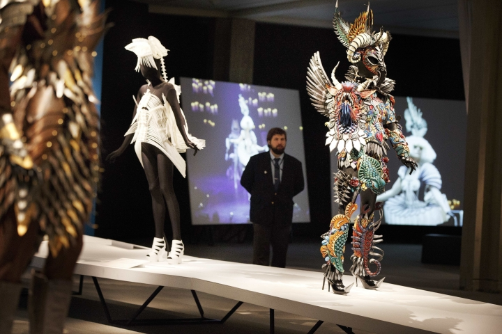 "In this Thursday, Feb. 16, 2017 photo, a guard stands amongst pieces included in the ""WOW - World of Wearable Art"" show at the Peabody Essex Museum in Salem, Mass. (AP Photo/Michael Dwyer)"