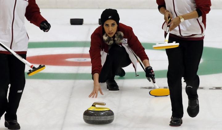 Qatar's Hanan Al Boinin throws a stone during a round-robin Curling game against Japan at the Asian Winter Games in Sapporo, northern Japan, Saturday, Feb. 18, 2017. (AP Photo/Shuji Kajiyama)