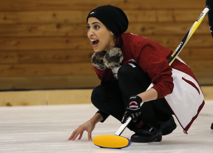 Qatar's Hanan Al Boinin shouts instructions to her teammates during a round-robin Curling game against Japan at the Asian Winter Games in Sapporo, northern island of Hokkaido, Saturday, Feb. 18, 2017. (AP Photo/Shuji Kajiyama)