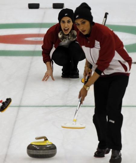 Qatar's Hanan Al Boinin shouts instructions to her teammates during a round-robin Curling game against Japan at the Asian Winter Games in Sapporo, northern Japan, Saturday, Feb. 18, 2017. (AP Photo/Shuji Kajiyama)