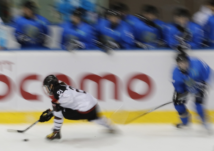 Japan's Hanae Kubo tries to get through Kazakhstan's defense during the women's tournament round robin ice hockey match at the Asian Winter Games at Tsukisamu Gymnasium in Sapporo, northern Japan, Saturday, Feb. 18, 2017. (AP Photo/Eugene Hoshiko)
