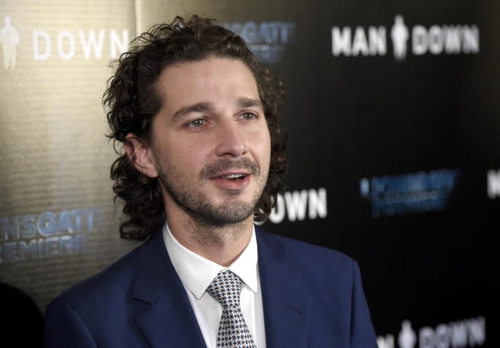 "FILE - In this Nov. 30, 2016 file photo, Shia LaBeouf arrives at the Los Angeles premiere of ""Man Down"" at ArcLight Cinemas Hollywood. LaBeouf has brought a performance-art piece against President Donald Trump to New Mexico's largest city. The Albuquerque Journal reports that LaBeouf, along with two other artists, brought on Saturday, Feb. 18, 2017, a 24-hour live-streaming camera mounted to a wall with the message in block letters: ""He will not divide us,"" referring to Trump. (Photo by Chris Pizzello/Invision/AP, File)"