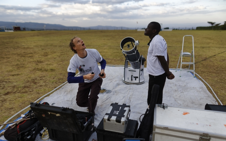 In this photo taken Friday, Feb. 3, 2017, astronomer and company co-founder Daniel Chu Owen, left, and an assistant, set up a telescope during a visit by The Traveling Telescope to show students the science of astronomy, at St Andrew's School near Molo in Kenya's Rift Valley. Although Kenya lies on the equator and has dramatic nighttime skies in rural areas, children find it hard to name planets and other bodies as astronomy is rarely taught in schools - but that is changing as The Traveling Telescope visits some of the country's most remote areas with telescopes and virtual reality goggles. (AP Photo/Ben Curtis)