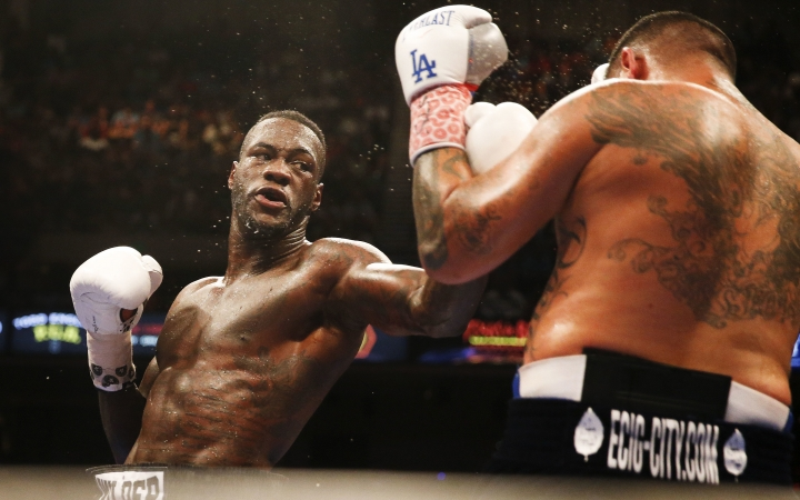 FILE - In this July 16, 2016, file photo, Deontay Wilder, left, throws a left at Chris Arreola during the WBC heavyweight title boxing bout in Birmingham, Ala. Wilder will not do much to advance his claim to the heavyweight crown Saturday, Feb. 25, 2017, when he defends his title against Gerald Washington, a fighter so unknown that even Wilder found it difficult to say much about him. (AP Photo/Brynn Anderson, File)