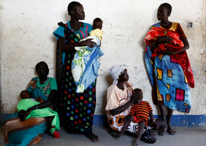 Women hold their babies as they wait for a medical check-up at a United Nations International Children's Fund (UNICEF) supported mobile health clinic in Nimini village, Unity State, South Sudan February 8, 2017. REUTERS/Siegfried Modola