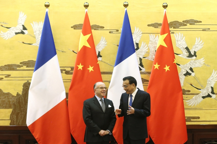Chinese Premier Li Keqiang, right, and French Prime Minister Bernard Cazeneuve talk during a signing ceremony at the Great Hall of the People in Beijing Tuesday, Feb. 21, 2017. Cazeneuve is in China for a three-day official visit. (Wu Hong/Pool Photo via AP)