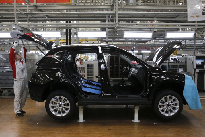 In this Sunday, Feb. 19, 2017 photo, a worker assembles a Haval SUV H3 model at the Great Wall Motors assembly plant in Baoding in north China's Hebei province. Great Wall Motors became China's most profitable automaker by making almost nothing but low-priced SUVs. Now it wants to expand into global markets. (AP Photo/Andy Wong)