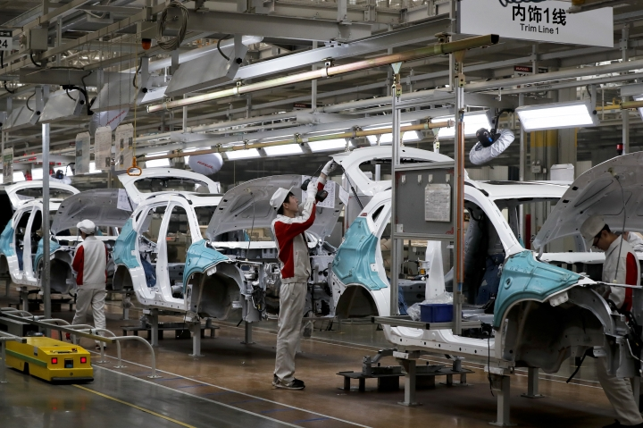 In this Sunday, Feb. 19, 2017 photo, workers assemble Haval SUV H2 models at the Great Wall Motors assembly plant in Baoding in north China's Hebei province. Great Wall Motors became China's most profitable automaker by making almost nothing but low-priced SUVs. Now it wants to expand into global markets. (AP Photo/Andy Wong)