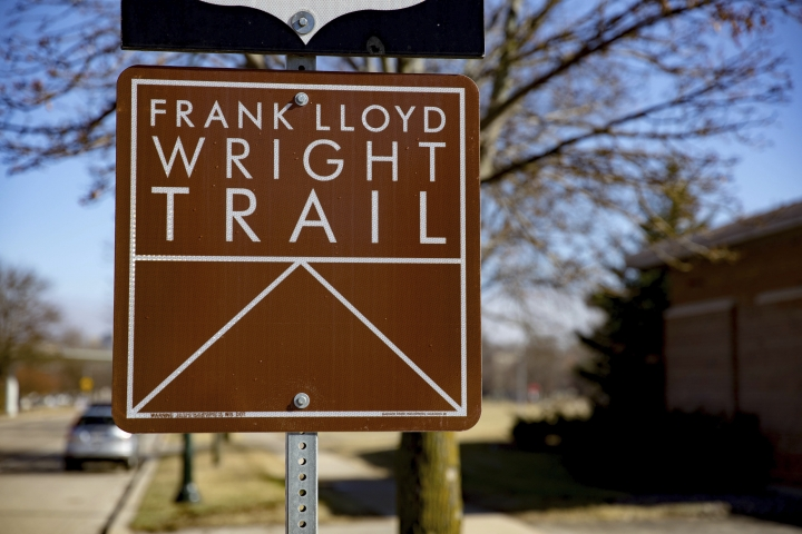 This Feb. 21, 2017 photo shows a sign in Madison, Wis., pointing the way to Monona Terrace, a site on Wisconsin's new Frank Lloyd Wright Trail. The 200-mile route highlights places around the state designed by the famous architect, who was born in Wisconsin 150 years ago on June 8, 1867. (Travel Wisconsin via AP)