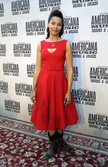"FILE - In this Wednesday, Sept. 16, 2015, file photo, Rhiannon Giddens arrives for the Americana Music Honors and Awards show in Nashville, Tenn. Giddens mines the pain and beauty of American social and musical history on ""Freedom Highway,"" a rich tapestry with threads of blues, folk, gospel, soul, country and jazz. (AP Photo/Mark Zaleski, File)"
