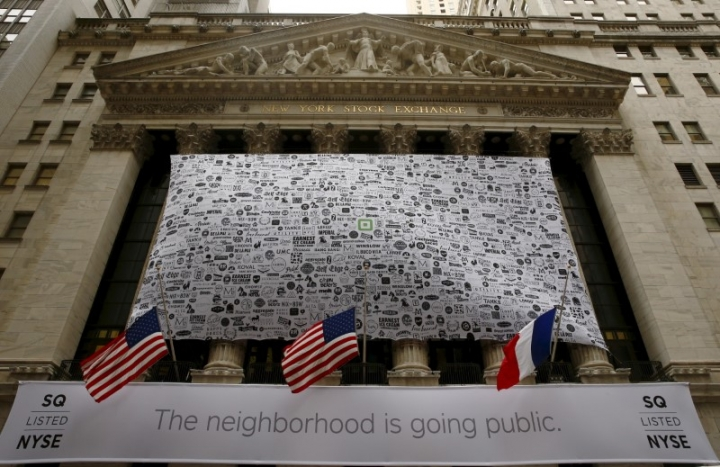 Signage for Square Inc. covers the front of the New York Stock Exchange celebrating the company's IPO November 19, 2015. REUTERS/Lucas Jackson