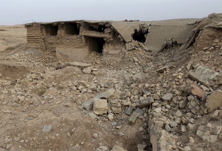 FILE - In this Wednesday, Nov. 16, 2016 file picture, part of the damaged ancient site of Nimrud, which were destroyed by the Islamic State militants, some 19 miles (30 kilometers) southeast of Mosul, Iraq. At a two-day UNESCO conference, Iraqi officials are asking for money and expertise to reclaim the cultural heritage that is on the verge of complete destruction by the Islamic State group. (AP Photo/Hussein Malla, File)