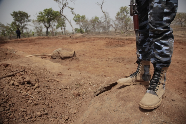 Security officers stand guard at the scene where a German archaeologists and his associate were kidnapped in Janjala Village, Nigeria. Friday, Feb. 24, 2017. Kidnappers are demanding a ransom of 60 million naira (about Dlrs 200,000 US) for the two captives abducted this week from Janjala village in northern Nigeria, the excavation site where the German archaeologists was working. Two villagers were shot and killed in the kidnapping, police confirmed Friday.(AP Photo/Lekan Oyekanmi )