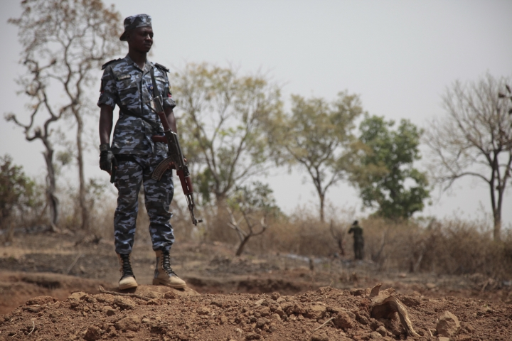 Security officers stand guard at the scene where a German archaeologists and his associate were kidnapped in Janjala Village, Nigeria. Friday, Feb. 24, 2017. Kidnappers are demanding a ransom of 60 million naira (about Dlrs 200,000 US) for the two captives abducted this week from Janjala village in northern Nigeria, the excavation site where the German archaeologists was working. Two villagers were shot and killed in the kidnapping, police confirmed Friday. (AP Photo/Lekan Oyekanmi )