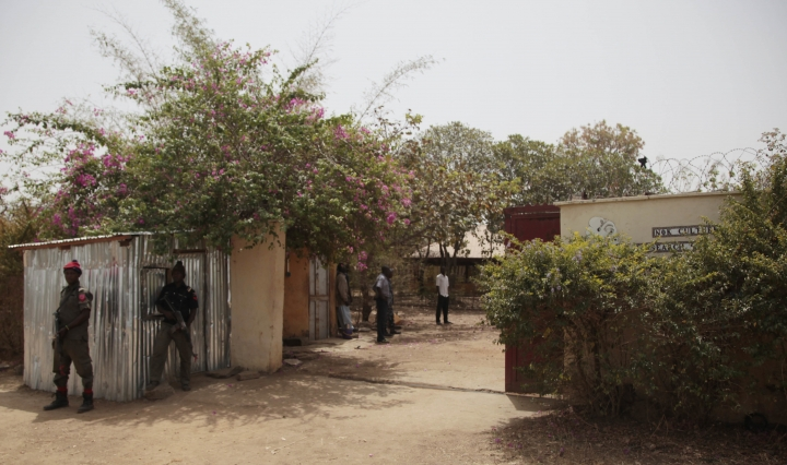 Security officers stand guard at the residence of abducted German archaeologists professor Peter Breunig and his associate Johannes Behringer in Janjala Village, Nigeria. Friday, Feb. 24, 2017. Kidnappers are demanding a ransom of 60 million naira (about Dlrs 200,000 US) for the two captives abducted this week from Janjala village in northern Nigeria, the excavation site where the German archaeologists was working. Two villagers were shot and killed in the kidnapping, police confirmed Friday. (AP Photo/Lekan Oyekanmi )