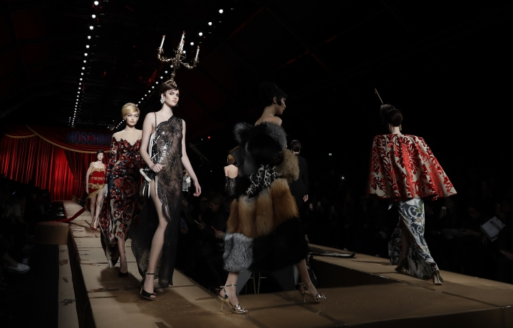 Models wear creations part of the Moschino women's Fall-Winter 2017-18 collection, that was presented in Milan, Italy, Thursday, Feb. 23, 2017. (AP Photo/Luca Bruno).