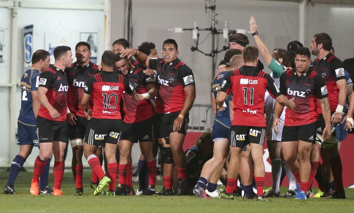 Crusaders player celebrate after scoring try against the Brumbies during their Super 15 rugby match in Christchurch, New Zealand, Saturday, Feb. 25, 2017. (AP Photo/Mark Baker)