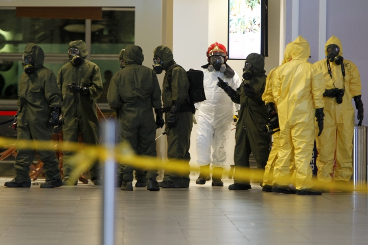 Hazmat crews are gathered at the main hall of Kuala Lumpur International Airport 2 in Sepang, Malaysia on Sunday, Feb. 26, 2017. Malaysian police ordered a sweep of Kuala Lumpur airport for toxic chemicals and other hazardous substances following the killing of Kim Jong Nam. (AP Photo/Daniel Chan)