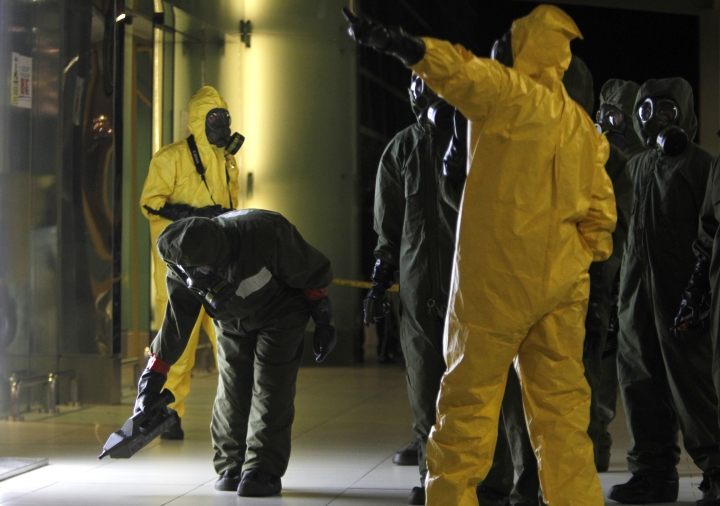 """A hazmat crew scan the decontamination zone at Kuala Lumpur International Airport 2 in Sepang, Malaysia on Sunday, Feb. 26, 2017. Malaysia's health minister said Sunday that the dose of nerve agent given to North Korean ruler Kim Jong Un's half brother was so high that it killed him """"within 15-20 minutes."""" A police official leading the investigations, said the terminal is """"free from any form of contamination of hazardous material"""" and declared it a """"safe zone"""" after a two-hour sweep. (AP Photo/Daniel Chan)"""