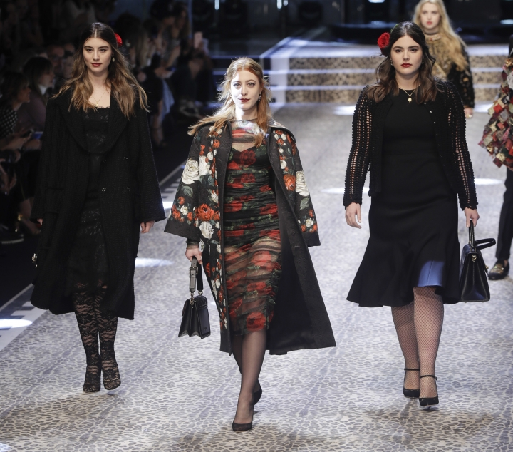 From left, Dominik, Daniella and Alessandra Garcia-Lorido daughters of actor Andy Garcia wear creations for Dolce&Gabbana women's Fall-Winter 2017-18 collection, in Milan, Italy, Sunday, Feb. 26, 2017. (AP Photo/Luca Bruno).