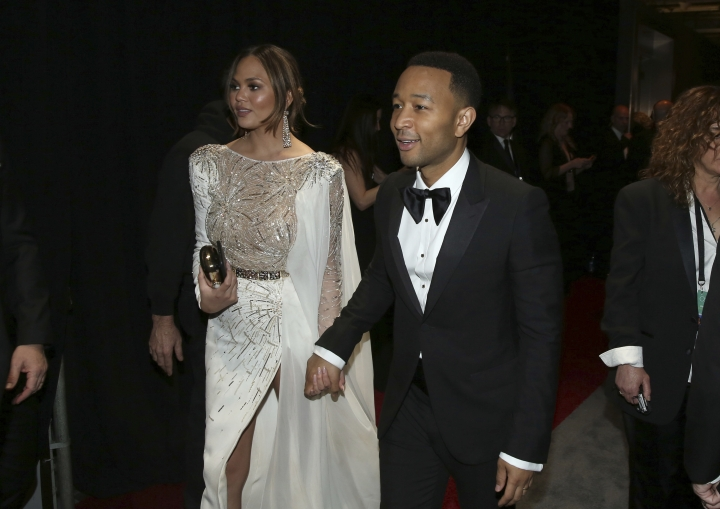 Chrissy Teigen, left, and John Legend appear backstage at the Oscars on Sunday, Feb. 26, 2017, at the Dolby Theatre in Los Angeles. (Photo by Matt Sayles/Invision/AP)