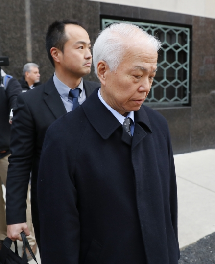 Takata Corp.'s chief financial officer Yoichiro Nomura leaves federal court in Detroit, Monday, Feb. 27, 2017. Japanese auto parts maker Takata Corp. pleaded guilty to fraud Monday and agreed to pay $1 billion in penalties for concealing an air bag defect blamed for at least 16 deaths, most of them in the U.S. (AP Photo/Paul Sancya)