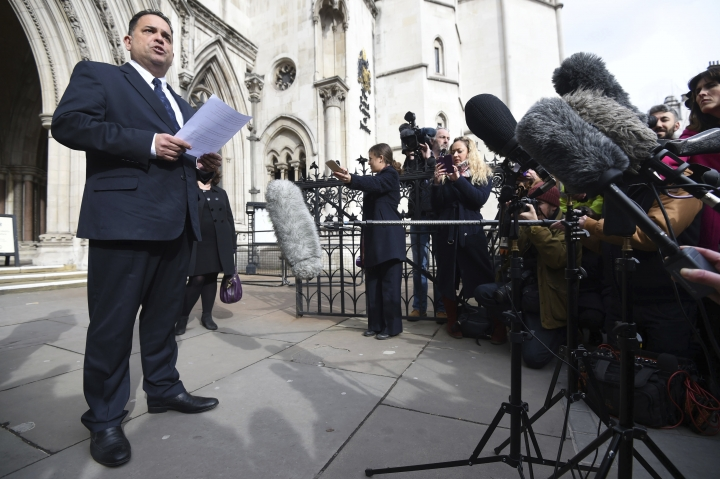 """Managing Director of travel company Tui Nick Longman reads a statement abouta deadly gun attack in Tunisia outside the Royal Courts of Justice in London Tuesday Feb. 28, 2017 . The coroner said the Tunisian police response to a deadly gun attack on the beach resort of Sousse was """"at best shambolic, at worst cowardly."""" Judge Nicholas Lorraine-Smith is delivering his findings Tuesday at an inquest into the deaths of 30 British tourists killed in the June 2015 attack at the five-star Riu Imperial Marhaba hotel. (Kirsty O'Connor/PA via AP)"""