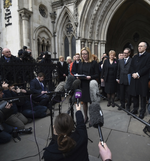 "Lawyer Kylie Hutchison, centre, reads out a statement on behalf of relatives of the victims of a deadly gun attack in Tunisia, outside the Royal Courts of Justice in London Tuesday Feb. 28, 2017 . The coroner said the Tunisian police response to a deadly gun attack on the beach resort of Sousse was ""at best shambolic, at worst cowardly."" Judge Nicholas Lorraine-Smith is delivering his findings Tuesday at an inquest into the deaths of 30 British tourists killed in the June 2015 attack at the five-star Riu Imperial Marhaba hotel. (Kirsty O'Connor/PA via AP)"