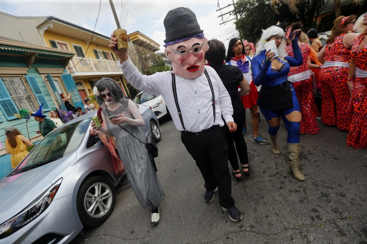 Revelers march through the streets during the Society of Saint Anne Mardi Gras parade in New Orleans, Tuesday, Feb. 28, 2017. (AP Photo/Gerald Herbert)