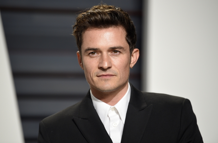"FILE - This Feb. 26, 2017 file photo shows Orlando Bloom at the Vanity Fair Oscar Party in Beverly Hills, Calif. Bloom and singer Katy Perry are breaking up after about a year together. Representatives for Perry and Bloom released a statement Wednesday saying: ""... we can confirm that Orlando and Katy are taking respectful, loving space at this time."" (Photo by Evan Agostini/Invision/AP, File)"