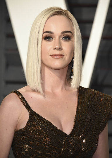 "FILE - This Feb. 26, 2017 file photo shows Katy Perry at the Vanity Fair Oscar Party in Beverly Hills, Calif. Perry and actor Orlando Bloom are breaking up after about a year together. Representatives for Perry and Bloom released a statement Wednesday saying: ""... we can confirm that Orlando and Katy are taking respectful, loving space at this time."" (Photo by Evan Agostini/Invision/AP, File)"