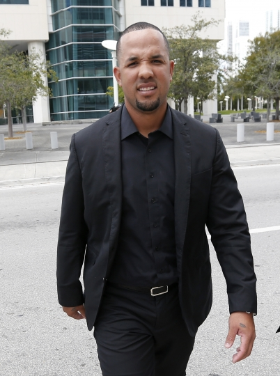 Chicago White Sox first baseman Jose Abreu leaves federal court during a break, Wednesday, March 1, 2017 in Miami. Abreu told a Miami federal jury he ate a chunk of a fake passport while flying to the U.S. to cover up his illegal travel as part of a Cuban ballplayer smuggling operation. The testimony came in the trial of agent Bartolo Hernandez and trainer Julio Estrada, who are accused of alien smuggling and conspiracy. (AP Photo/Wilfredo Lee)