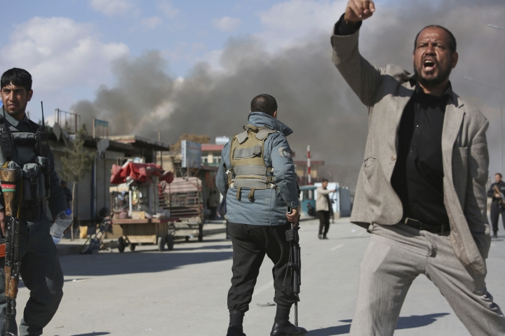 Afghan security forces respond to a suicide attack in Kabul, Afghanistan, Wednesday, March 1, 2017. A pair of suicide bombings, both claimed by the Taliban, struck the Afghan capital, an Afghan official said. (AP Photo/Rahmat Gul)