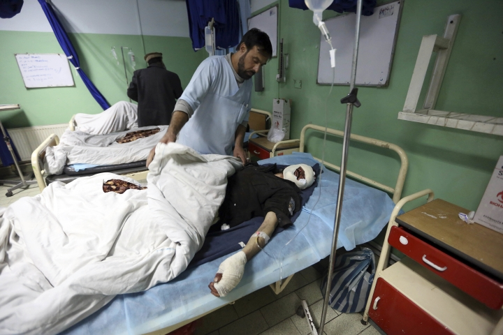 Injured men recover at a hospital after a suicide attack in Kabul, Afghanistan, Wednesday, March 1, 2017. A pair of suicide bombings, both claimed by the Taliban, struck the Afghan capital, an Afghan official said. (AP Photo/Rahmat Gul)