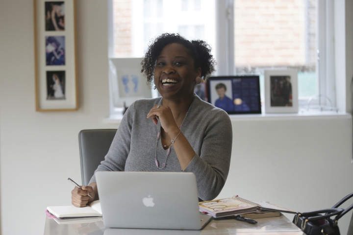 In this photo taken on Monday, Feb. 27, 2017, Spacehop user Lavinia Osbourne poses for a picture in one of the homes available for hire as office space on the Spacehop website, in London. The rise of self-employment and soaring office costs are fueling demand for shared office space in metropolitan areas, with a handful of firms renting workspace by the hour, similar to the way Airbnb offers overnight stays. Vrumi, founded in 2015, says it has 5,000 registered users and 120,000 square feet of rentable workspace across the U.K. London-based Spacehop joined the market last year, as did Breather, a four-year-old company that also operates in the U.S. and Canada. (AP Photo/Tim Ireland)