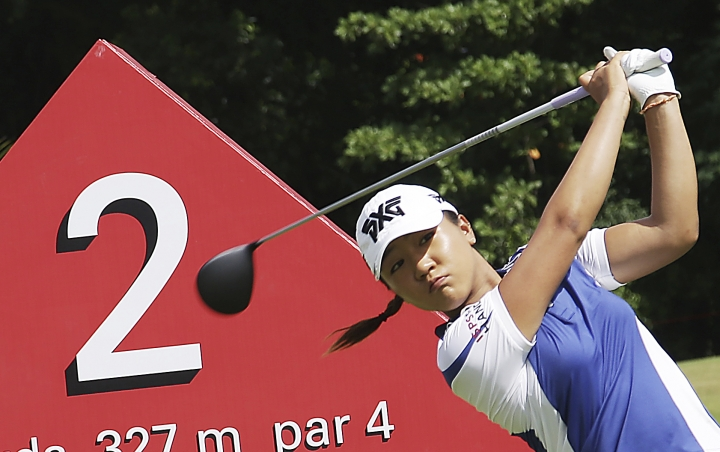 Lydia Ko of New Zealand tees off on the second hole during the HSBC Women's Champions golf tournament held at Sentosa Golf Club's Tanjong course on Thursday, March 2, 2017, in Singapore. (AP Photo/Wong Maye-E)