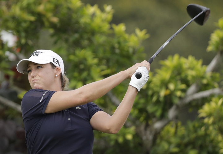 CORRECTS FIRST NAME OF KERR - Cristie Kerr of the United States tees off on the third hole during the HSBC Women's Champions golf tournament held at Sentosa Golf Club's Tanjong course on Thursday, March 2, 2017, in Singapore. (AP Photo/Wong Maye-E)