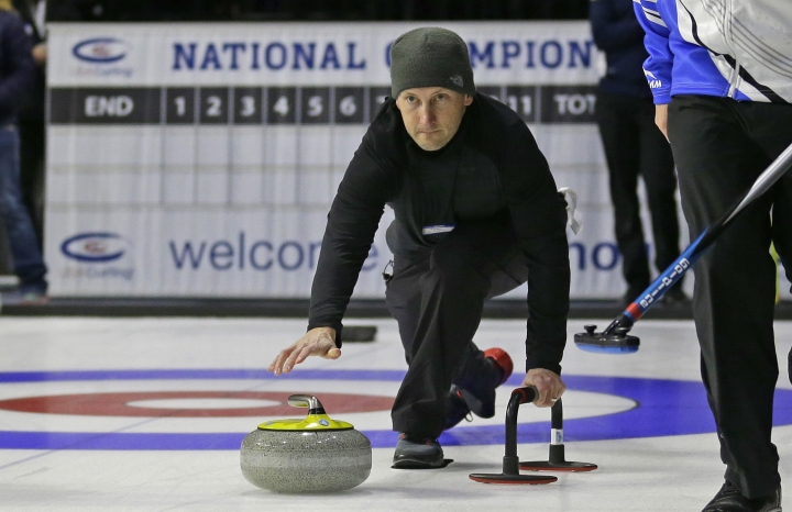 In this Wednesday, March 1, 2017 photo, Associated Press sportswriter Tim Booth, center, tries his hand at curling during a media demonstration the day before the opening ceremonies of the USA Curling Nationals in Everett, Wash. Watching from afar, curling looks like a marriage of shuffleboard and bocce ball on ice that requires about the same amount of physical ability. What I learned trying out the sport for the first time is the stereotypes about curling are pretty much false. These competitors are athletes and it's a lot of work. (AP Photo/Ted S. Warren)
