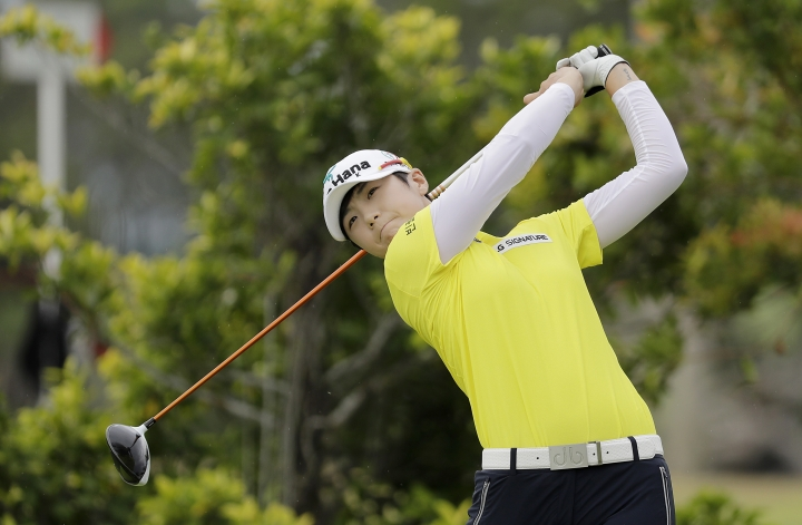Sung Hyun Park of South Korea tees off on the 3rd hole during the HSBC Women's Champions golf tournament held at Sentosa Golf Club's Tanjong course on Friday, March 3, 2017, in Singapore. (AP Photo/Wong Maye-E)