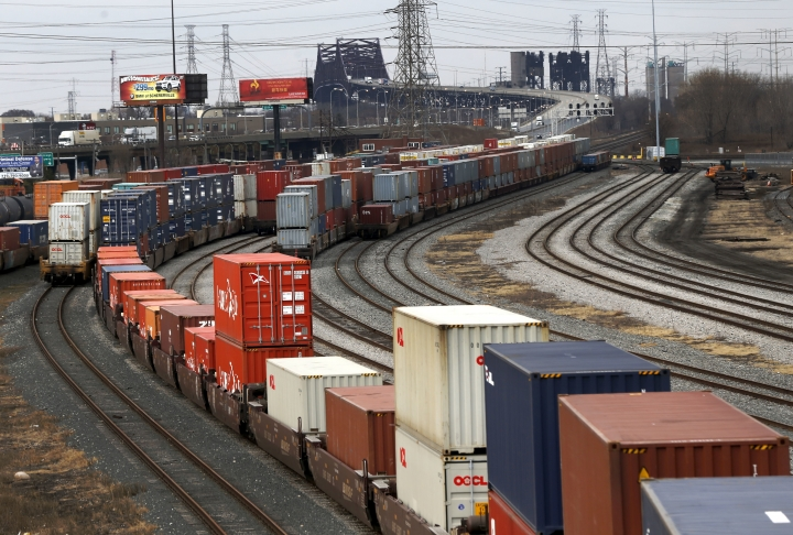 In this Tuesday, Feb. 21, 2017, photo, railcars are positioned in Hammond, Ind., to cross over the Calumet River into Chicago. The 2015 heist of over 100 guns, preceded by one in 2014, and another last September from a Chicago rail yard highlight a tragic confluence. Chicago's biggest rail yards are on the gang- and homicide-plagued South and West Sides where most of the city's hundreds of killings happened last year. Residents near the yard are angry the multibillion-dollar railroad isn't doing more to stop the thefts. (AP Photo/Charles Rex Arbogast)