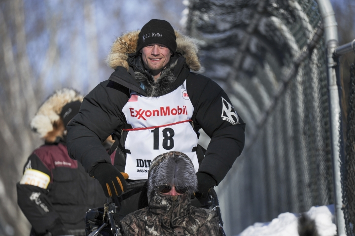 Four-time and defending champion Dallas Seavey mushes through the woods during the ceremonial start of the Iditarod Trail Sled Dog Race in Anchorage, Alaska, Saturday, March 4, 2017. (AP Photo/Michael Dinneen)